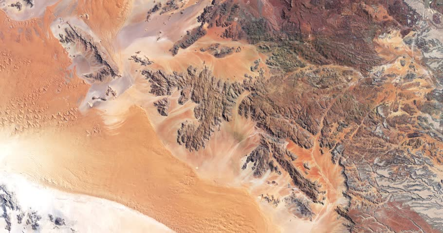 High-altitude overflight aerial of rocky terrain in the Namib desert.. Clip loops and is reversible. Elements of this image furnished by NASA