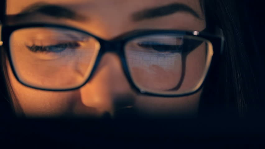 Attractive young woman  typing on tablet touch screen. Reflection of tablet in glasses. | Shutterstock HD Video #21460513