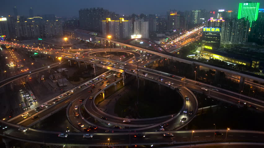 Shanghai, China - March 2016: Busy elevated stacked road junction at dusk   Shutterstock HD Video #21480937