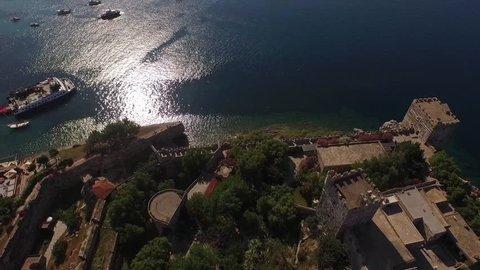 Marina castle aerial yacht drone shot Turkish flag business boat harbor luxury tourism coastline travel Bodrum Mugla, Turkey