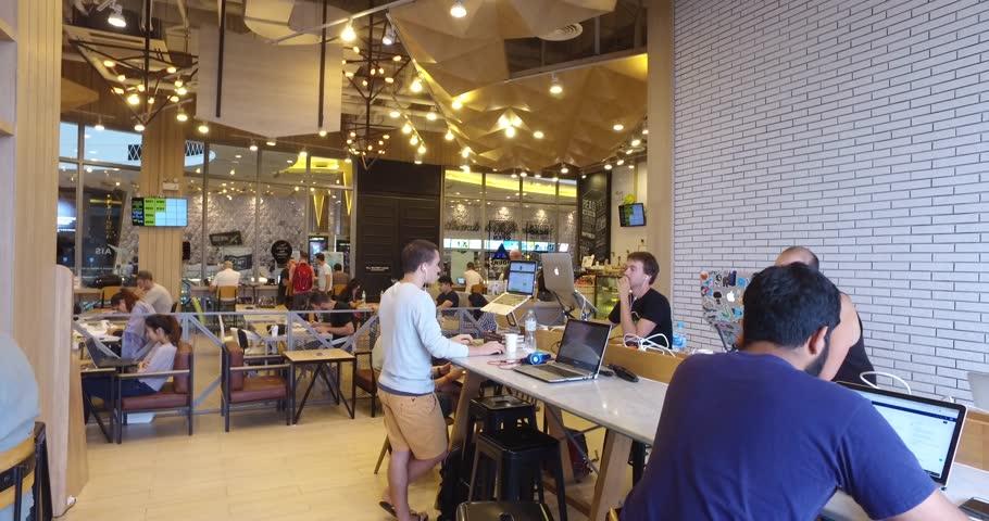 CHIANG MAI,THAILAND - CIRCA November 2016 :4k pov of millenials working on laptops