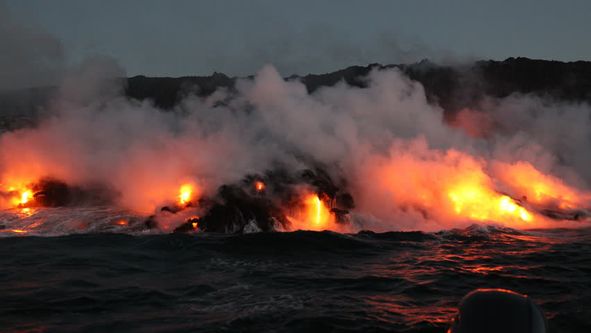 Lava running in the ocean from volcanic lava eruption on Big Island Hawaii. Seen from lava boat tour. Lava from Kilauea volcano by Hawaii volcanoes national park, USA. Dawn, steadicam, 59.94 FPS. 2016