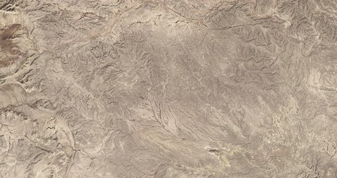 High-altitude overflight aerial of rocky desert near the Mexico/Texas border. Clip loops and is reversible. Elements of this image furnished by NASA