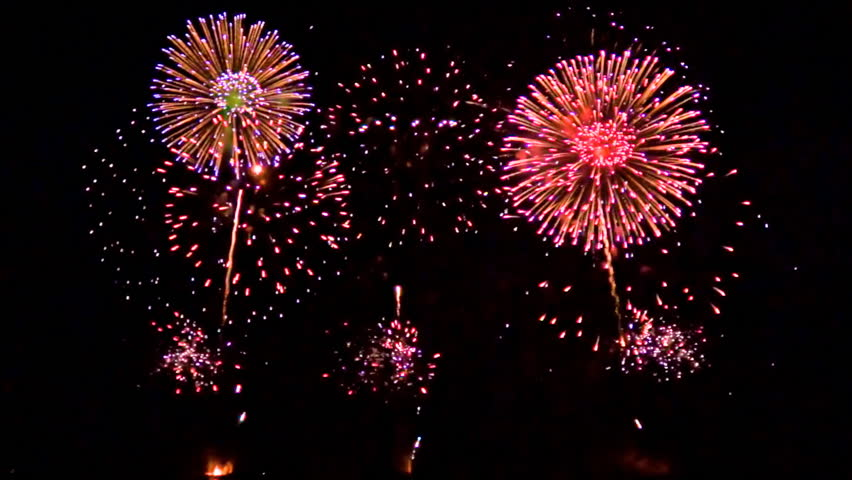 Multiple fireworks exploding high in the air. FullHD 1080p.