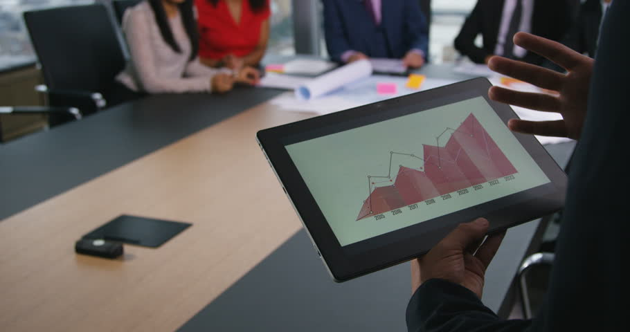 4k, An executive leading a digital presentation to colleagues in a large boardroom.   Shutterstock HD Video #21523627