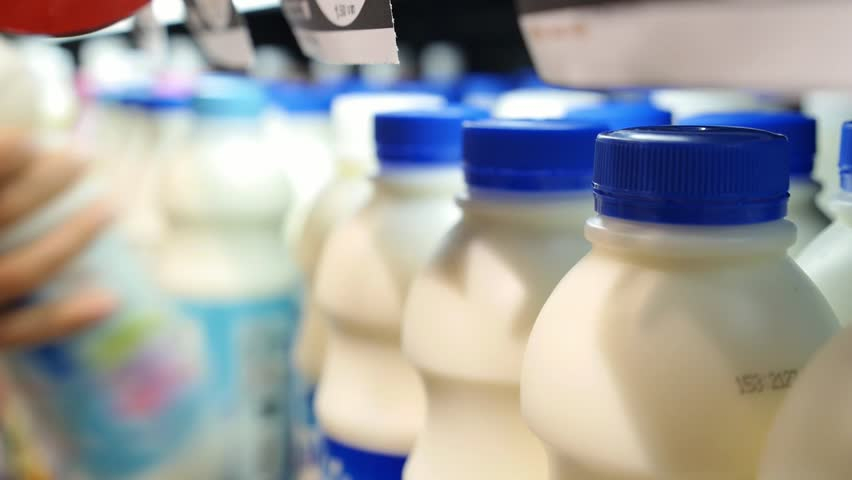 Shopping for Dairy Product in Grocery Store. Choosing Milk | Shutterstock HD Video #21591727