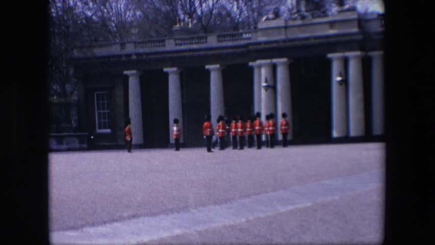 LONDON ENGLAND 1967: beefeater soldiers marching and standing in formation in front of building with white columns