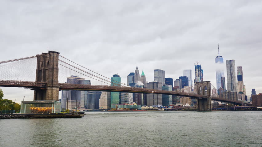 Day light brooklyn bridge panorama 4k time lapse from new york skyscrapers of manhattan and brooklyn bridge new york city fast clouds float over the malvernweather Gallery