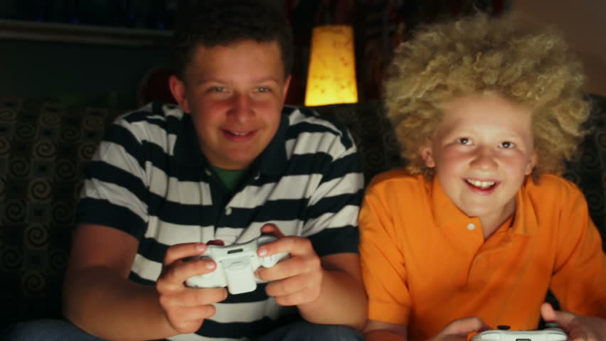 Young boys playing video games.