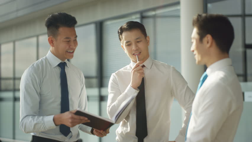 4K Businessmen talking shake hands in crowded area of large modern office (UK-Oct 2016) | Shutterstock HD Video #21774574