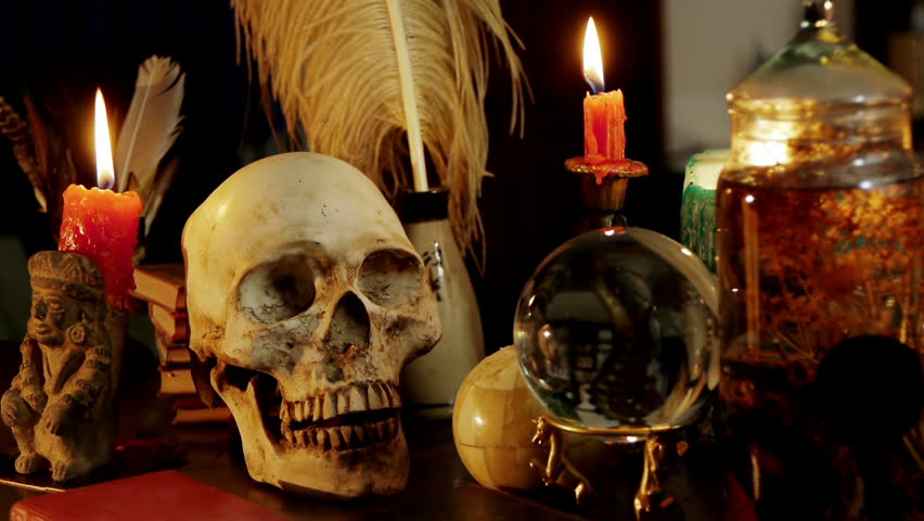 Skull Witchcraft Desk Artifacts (HD). Occult study setup desk with a skull chandelier, candles, crystal ball, books, and other occult paraphernalia. Skull is resin replica not real.