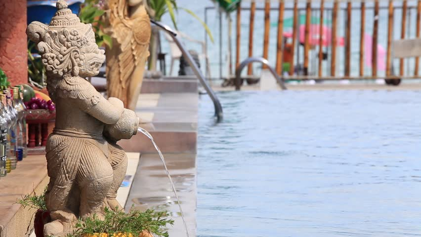 Traditional Thai Sculpture With A Fountain On The Beach Near Swimming Pool Sea
