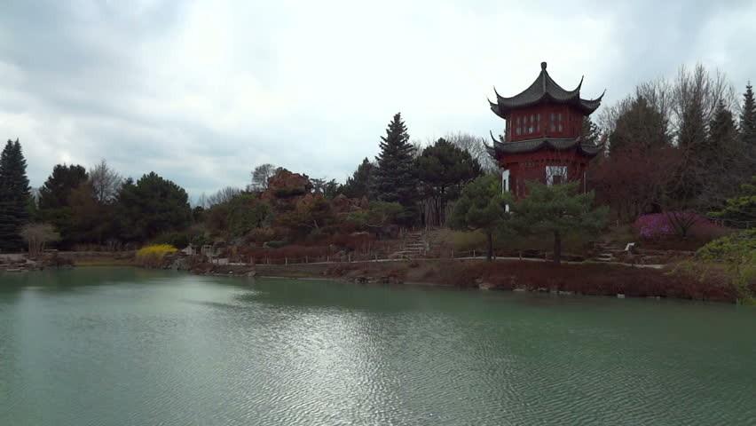 Old buddhist temple located near a calm lake.