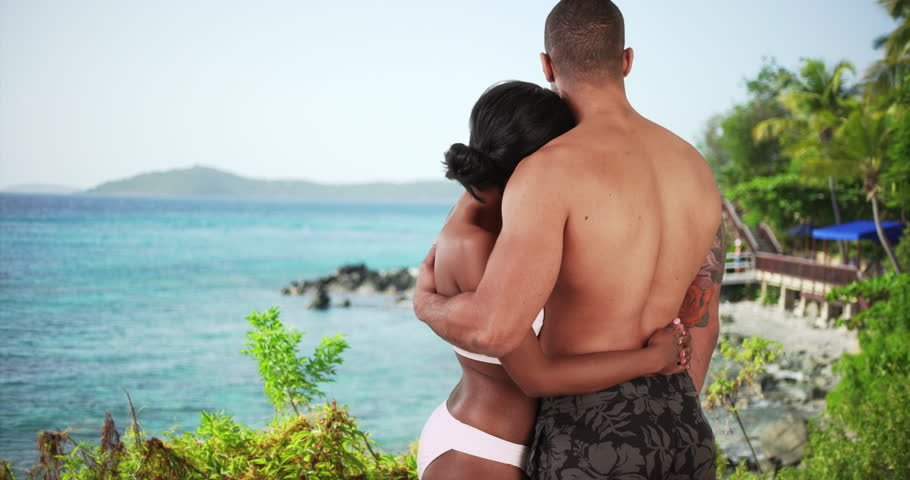 Black couple on honeymoon in Caribbean looking out over the ocean. Man and woman on vacation at island resort in love. 4k | Shutterstock HD Video #21852607