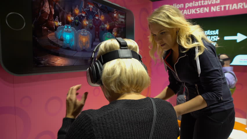 HELSINKI, FINLAND - NOVEMBER 4, 2016:  Woman uses VR head-mounted displays during the GAME EXPO in the exhibition center Messukeskus.