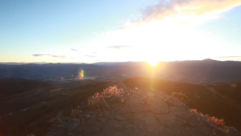 A man standing by the sunset  on a mountain   Shutterstock HD Video #21891937