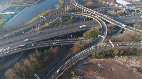 Tilting aerial view of Spaghetti Junction and Birmingham city centre, UK.
