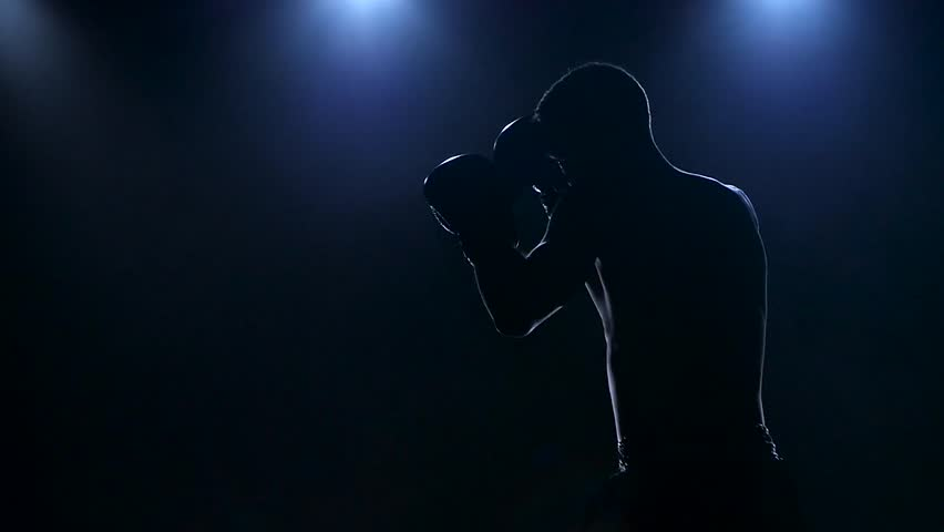 Right hook. Workout boxer in the dark studio. Slow motion #21917257