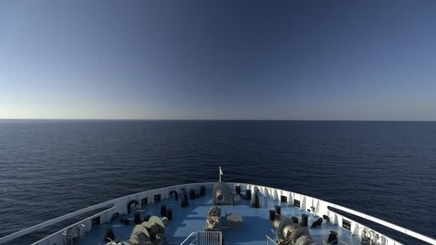 Blue sky and ocean - 50-50 level horizon line with ship bow