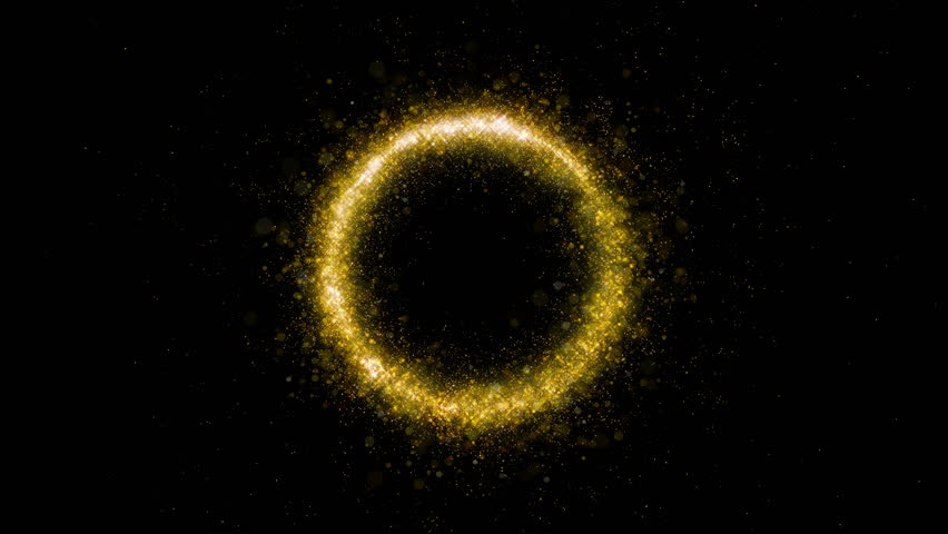 Gold glittering star dust circle of trail sparkling particles on black background. Magic golden flying particles.
