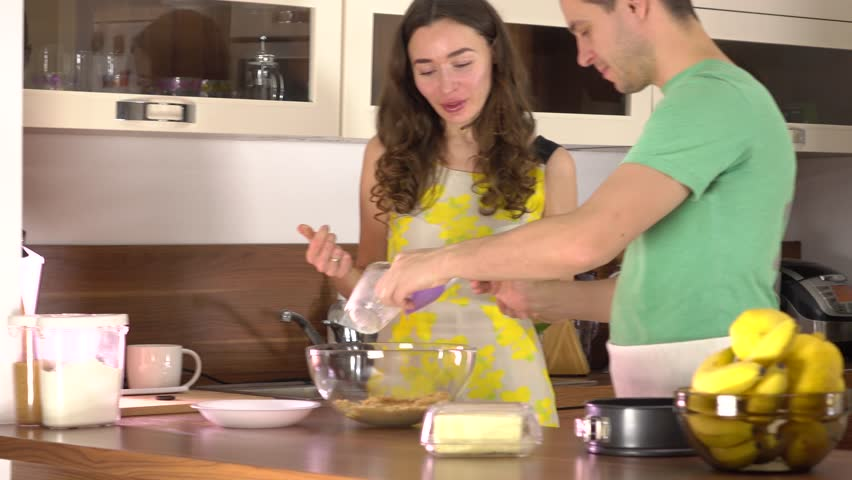 Man and woman cooking dessert together at home. 4K steadicam video | Shutterstock HD Video #21980647