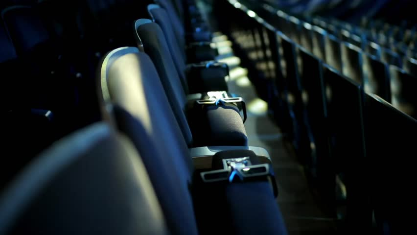Empty theater auditorium or cinema with dark blue or black seats. Modern cinema auditorium with 3d glasses and many rows of seats. Dark movie theatre ready for projection. #21999898