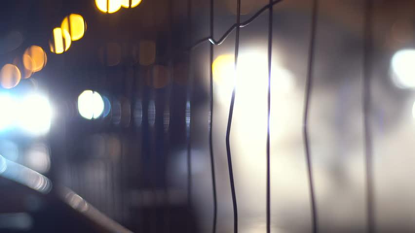 Street Traffic Behind Metal Fence | Shutterstock HD Video #22002037