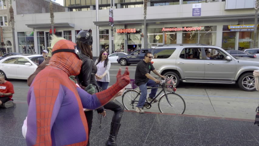 LOS ANGELES - OCT 17, 2016: Spiderman Yoda And Catwoman Posing For Photo On Walk Of Fame Hollywood Boulevard Los Angeles CA. Actors in superhero costumes and other characters perform for tips in LA.