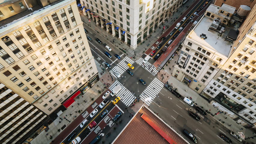 NEW YORK CITY - NOVEMBER 17: (TIMELAPSE) Aerial view of intersection with pedestrian and vehicle traffic flowing on West 34th Street and 5th Ave on November 17, 2016 in New York, USA.