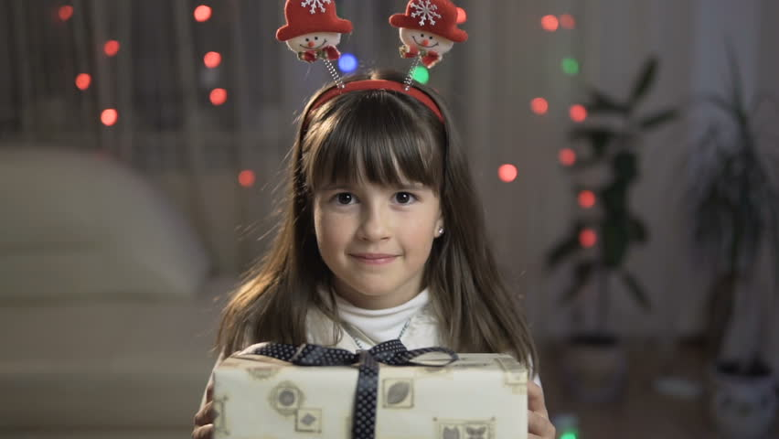 Young happy smiling girl giving a christmas gift box | Shutterstock HD Video #22048117
