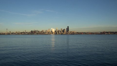 Time lapse scene showing a complete day to night transition of the Seattle skyline  as seen from Alki Beach