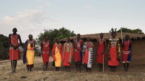 maasai women and men sing then dance together in pairs at a village near masai mara in kenya