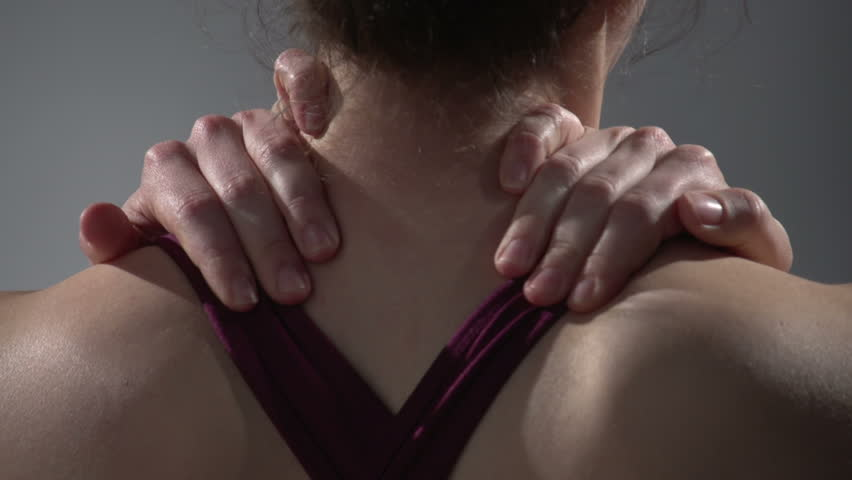 Back pain, woman rubbing her neck