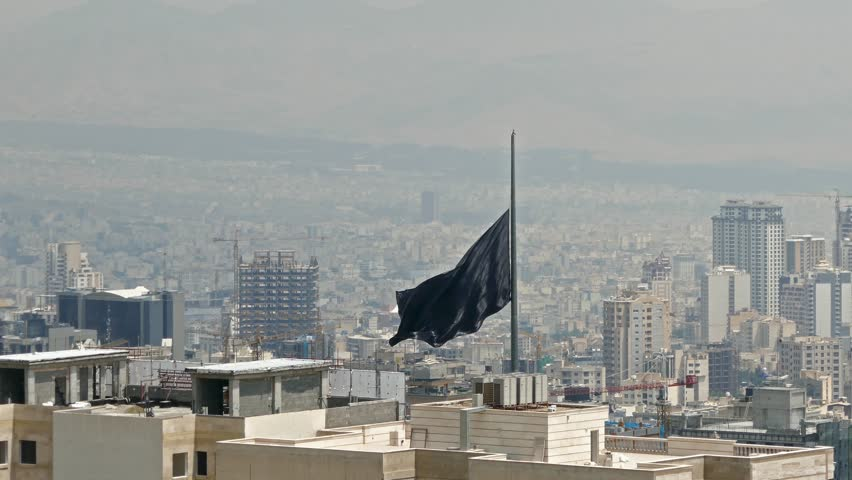 Black flag the symbol of Islam waving in wind over buildings of a big city | Shutterstock HD Video #22158991