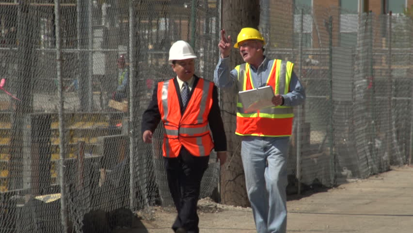 Construction worker and business man visiting construction site