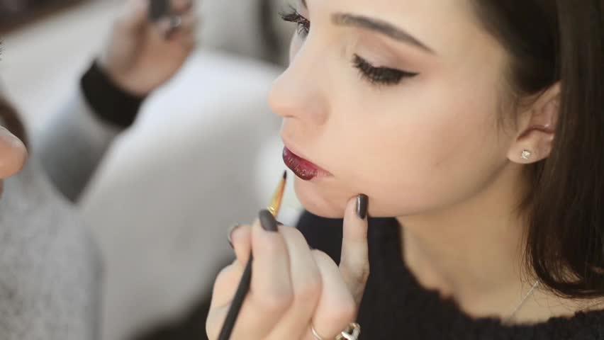 Professional Makeup Artist Paints A Model Lipsmakeup Slow Motion