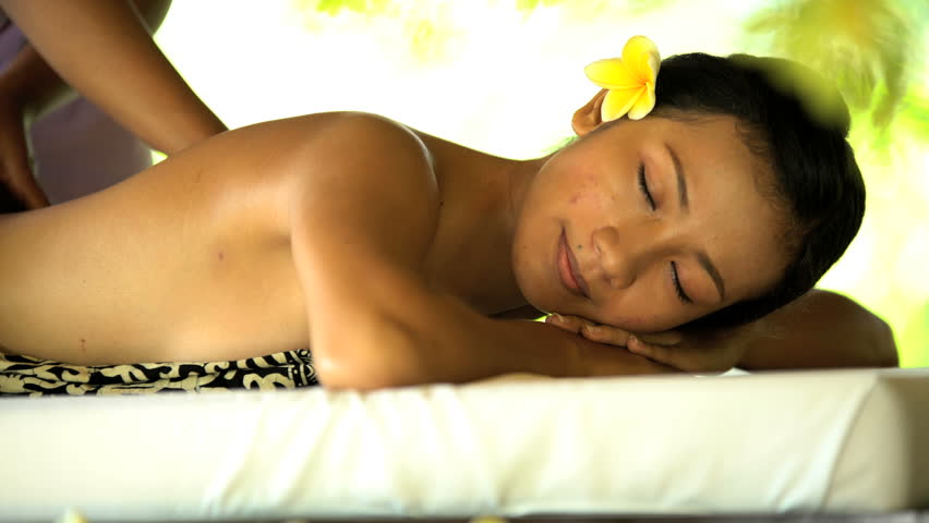 Reward of relaxing therapeutic massage for Asian female business traveller  at luxury spa resort in Bali