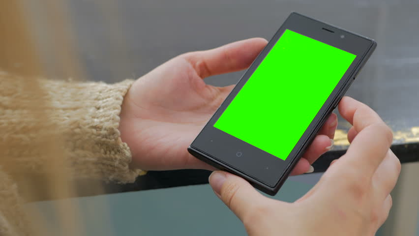 Woman looking at vertical smartphone with green screen. Close up shot of woman's hands with mobile | Shutterstock HD Video #22216906