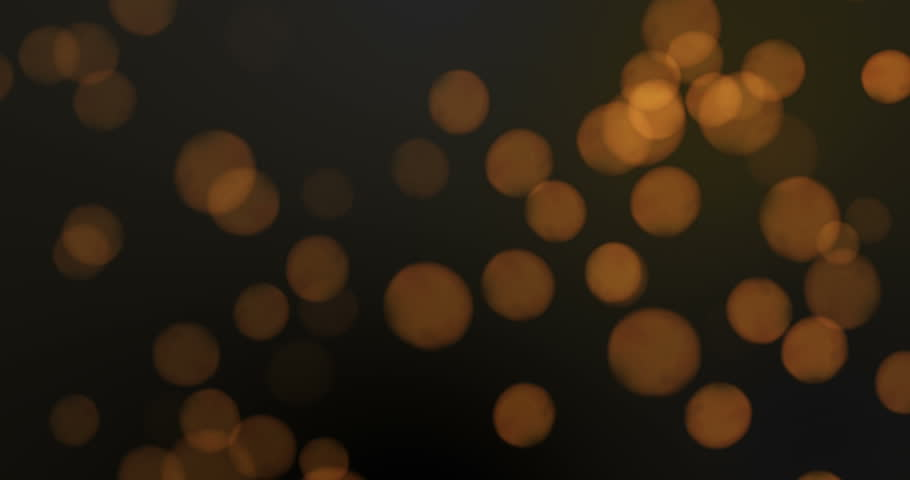 Orange Bokeh Lights Background Loop. Moving Particles. Black Abstract Background.