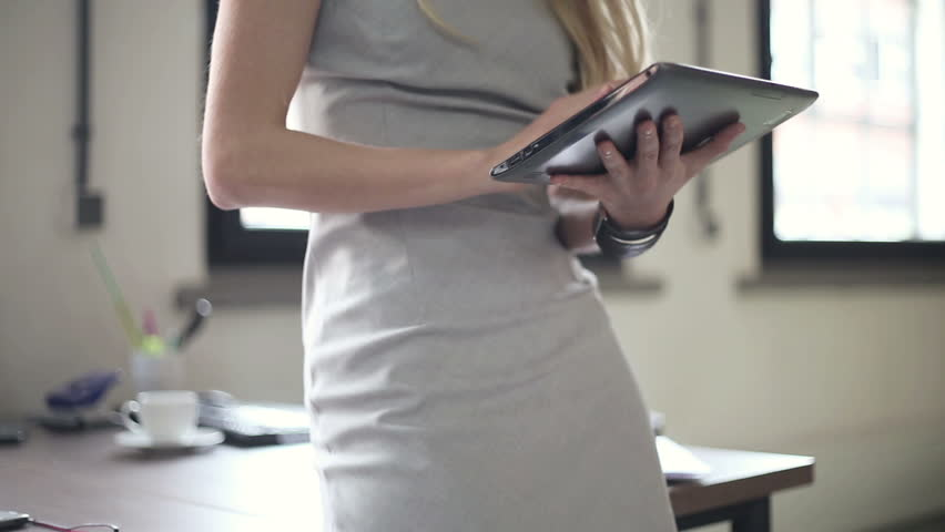 Businesswoman working on tablet computer in office, stabilized shot | Shutterstock HD Video #2224687