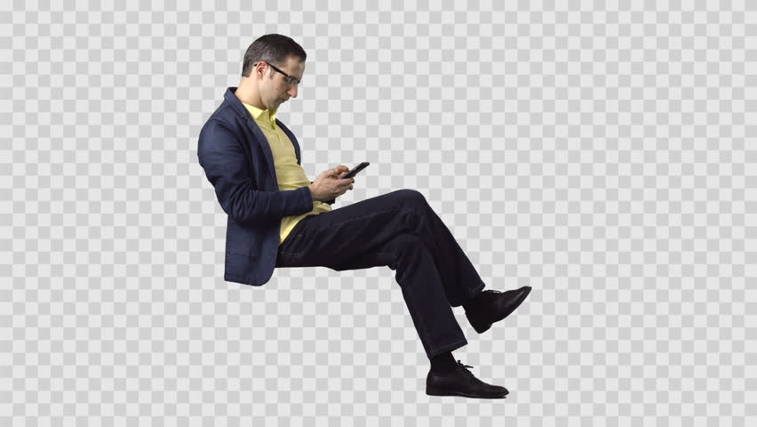 Male in denim jacket is sitting, looking at smartphone. Transparent background