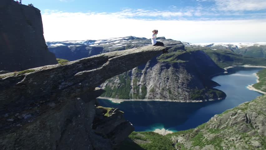 aerial 4K close-up video  of Trolltunga or Troll tongue, Norway, one of the world most famous cliff captured by professional drone camera