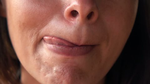 Close up of woman licking her lips, super slow motion 240fps