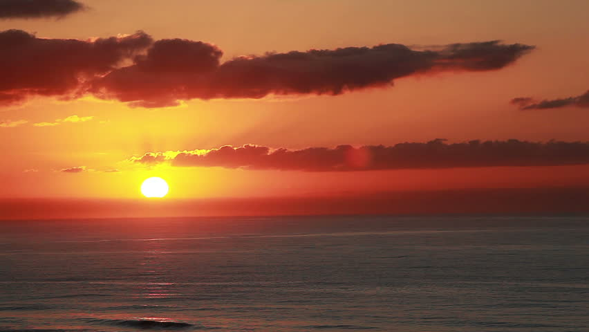 Sunrise at the beach with pretty orange cloudy sky is the view from a Myrtle Beach South Carolina condo balcony