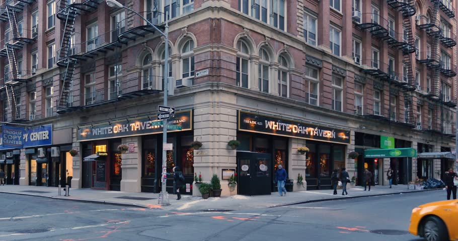 NEW YORK - Circa December, 2016 - A daytime winter establishing shot of a typical Manhattan corner bar and restaurant.