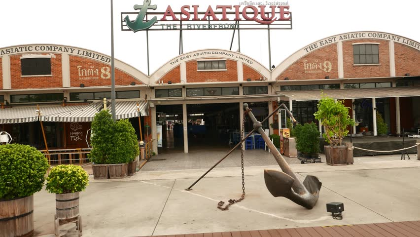 BANGKOK - MARCH 19, 2015: Asiatique The Riverfront facade and empty main passage, slide move aside restaurant terraces and old dock buildings, restyled to vintage restaurants and shopping centre