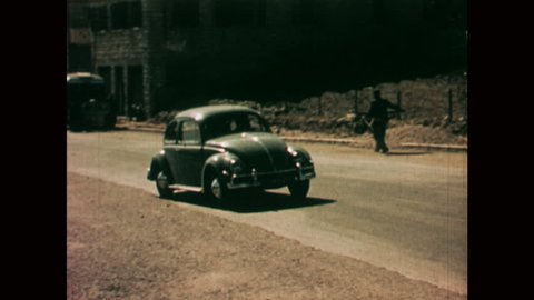 NAZARETH, ISRAEL: 1960s: VW car drives through street in Nazareth.