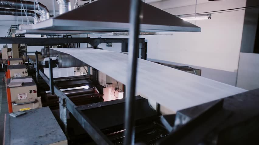 Paper in the process of a printing machine work. Printing establishment detail on production line with sound.   Shutterstock HD Video #22477342