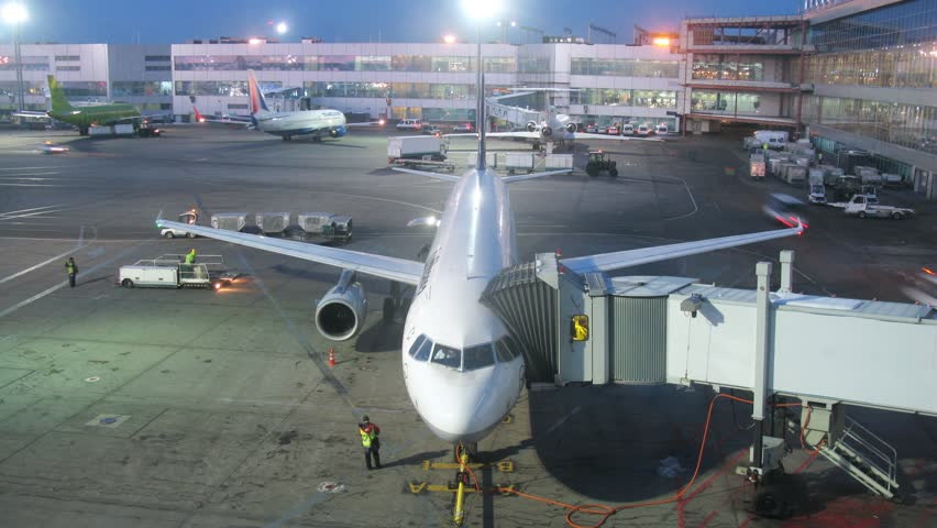 MOSCOW - MAR 7: (Timelapse View) Plane stands in territory of Domodedovo airport in evening, on March 7, 2012 in Moscow, Russia