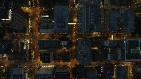 Aerial vertical overhead rooftop illuminated view of Chicago city streets road traffic and Downtown Skyscraper buildings Business and Financial District USA Illinois RED DRAGON